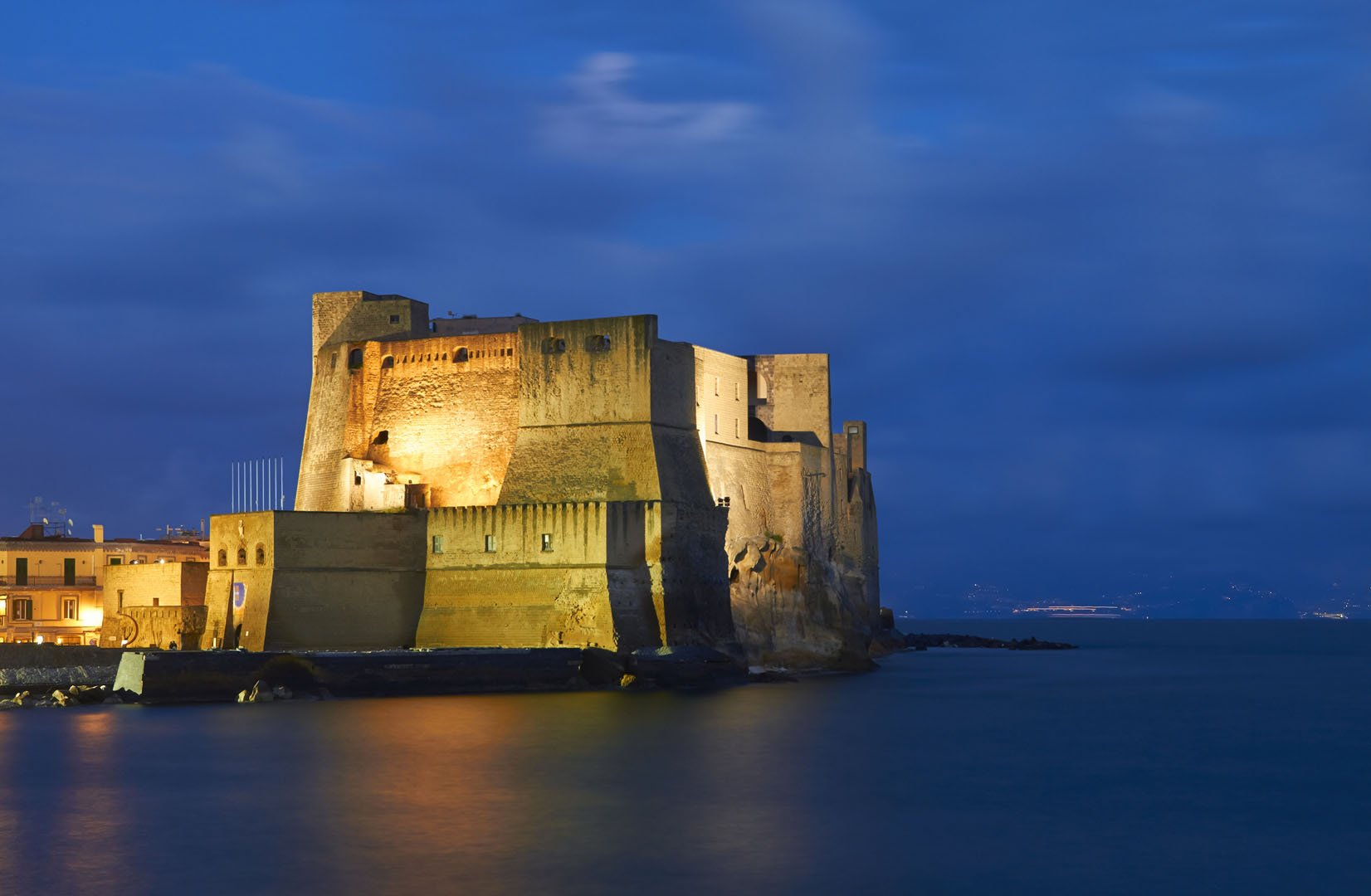 Naples, Castel dell'Ovo at dusk.